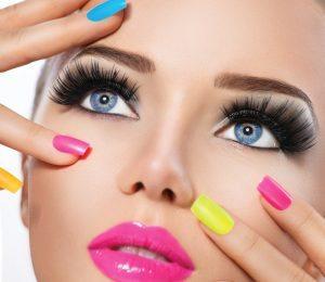 Beauty girl portrait with vivid makeup and colorful nail polish