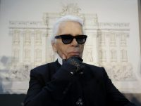 "WCENTER 0SNBCIREDD                Designer Karl Lagerfeld poses for photographers prior to the start of a press conference, in Rome, Monday, Jan. 28, 2013. The Fendi fashion house is financing an euro 2.12 million ($2.8 million) restoration of Trevi Fountain in Rome, famed as a setting for the film ""La Dolce Vita'' and the place where dreamers leave their coins. The 20-month project on one of the city's most iconic fountains was being unveiled at a city hall press conference Monday. (LaPresse/AP Photo/Gregorio Borgia)"