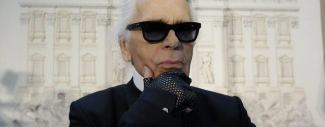 """WCENTER 0SNBCIREDD                Designer Karl Lagerfeld poses for photographers prior to the start of a press conference, in Rome, Monday, Jan. 28, 2013. The Fendi fashion house is financing an euro 2.12 million ($2.8 million) restoration of Trevi Fountain in Rome, famed as a setting for the film """"La Dolce Vita'' and the place where dreamers leave their coins. The 20-month project on one of the city's most iconic fountains was being unveiled at a city hall press conference Monday. (LaPresse/AP Photo/Gregorio Borgia)"""