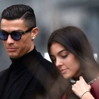 uventus' forward and former Real Madrid player Cristiano Ronaldo leaves with his Spanish girlfriend Georgina Rodriguez after attending a court hearing for tax evasion in Madrid on January 22, 2019. - Ronaldo is expected to be given a hefty fine after Spanish tax authorities and the player's advisors made a deal to settle claims he hid income generated from image rights when he played for Real Madrid. (Photo by OSCAR DEL POZO / AFP)