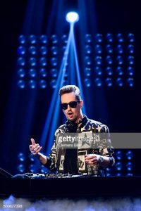 BERLIN, GERMANY - DECEMBER 10: Robin Schulz performs on stage of the 'The Voice Of Germany - Semi Final' on December 10, 2015 in Berlin, Germany.  (Photo by Clemens Bilan/Getty Images)