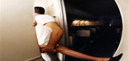Couple in Airplane Lavatory --- Image by © Patrik Giardino/CORBIS