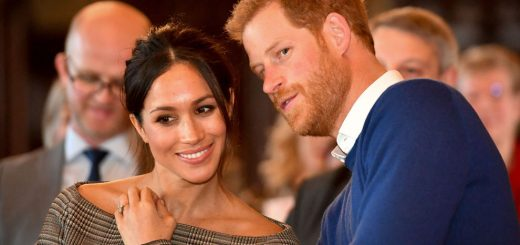Prince Harry whispers to Meghan Markle as they watch a dance performance by Jukebox Collective in the banqueting hall during a visit to Cardiff Castle. PRESS ASSOCIATION Photo. Picture date: Thursday January 18, 2018. See PA story ROYAL Harry. Photo credit should read: Ben Birchall/PA Wire
