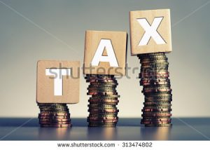stock-photo-tax-concept-with-wooden-block-on-stacked-coins-313474802[1]