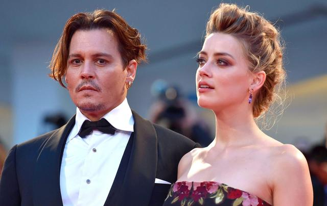 epa05329503 (FILE) A file picture dated 05 September 2015 shows US actress/cast member Amber Heard (R) and her husband US actor Johnny Depp (L) arriving for the premiere of 'The Danish Girl' during the 72nd annual Venice International Film Festival, in Venice, Italy. According to media reports on 26 May 2016, Johnny Depp and Amber Heard are set to divorce.  EPA/ETTORE FERRARI