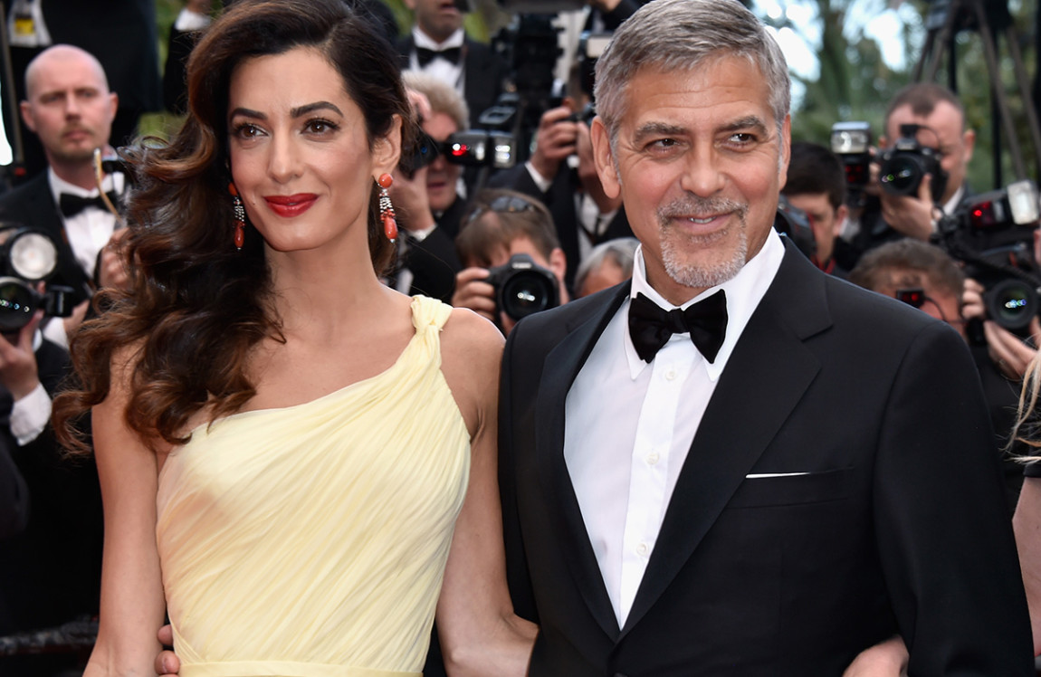 "CANNES, FRANCE - MAY 12:  Lawyer Amal Clooney (L) and actor George Clooney attend a screening of ""Money Monster"" at the annual 69th Cannes Film Festival at Palais des Festivals on May 12, 2016 in Cannes, France.  (Photo by Pascal Le Segretain/Getty Images)"