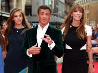 epa04341054 US actor Sylvester Stallone (C), his wife Jennifer Flavin (R) and their daughter Sistine arrive for the world premiere of 'The Expendables 3' at the Odeon Leicester Square in London, Britain, 04 August 2014. The movie opens in British theaters on 14 August.  EPA/SEAN DEMPSEY