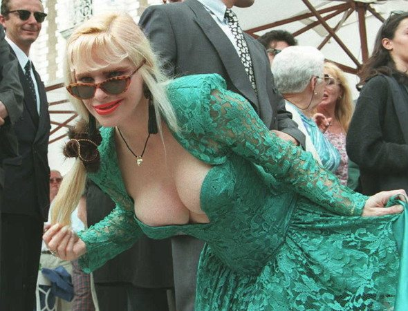 CANNES, FRANCE - MAY 15:  La Cicciolina, former Italian porno-star and former member of Italian Parliament, poses for photographers 15 May on the steps of one of the hotels on the Croisette at Cannes. La Cicciolina attended the X-award ceremony for the best porno-movies, on the fringes of the 49th International Film Festival.  (Photo credit should read ANDRE DURAND/AFP/Getty Images)