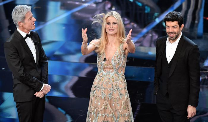 Italian singer and Sanremo Festival artistic director Claudio Baglioni (L), Swiss-Italian TV showgirl Michelle Hunziker (C) and Italian actor Pierfrancesco Favino (R) on stage during the 68th Sanremo Italian Song Festival at the Ariston theatre in Sanremo, Italy, 07 February 2018. The 68th edition of the television song contest runs from 06 to 10 February. ANSA/ETTORE FERRARI